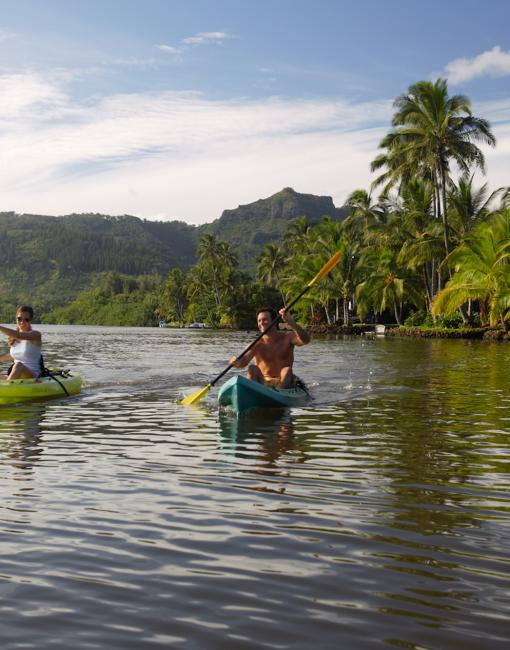 A couple kayaks on the Wailua River on Kauai