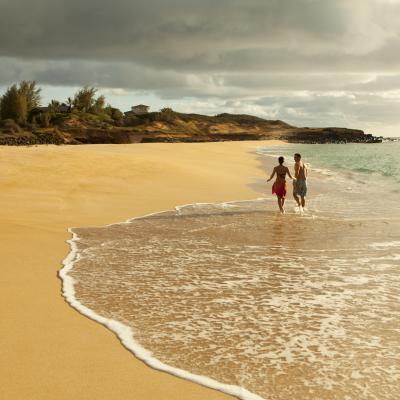 A couple on an empty beach in the west end of Molokai