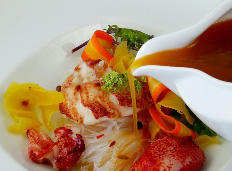 Keahole Lobster in tamarind broth, long rice, crispy pork belly, kaffir lime, green papaya, crustace