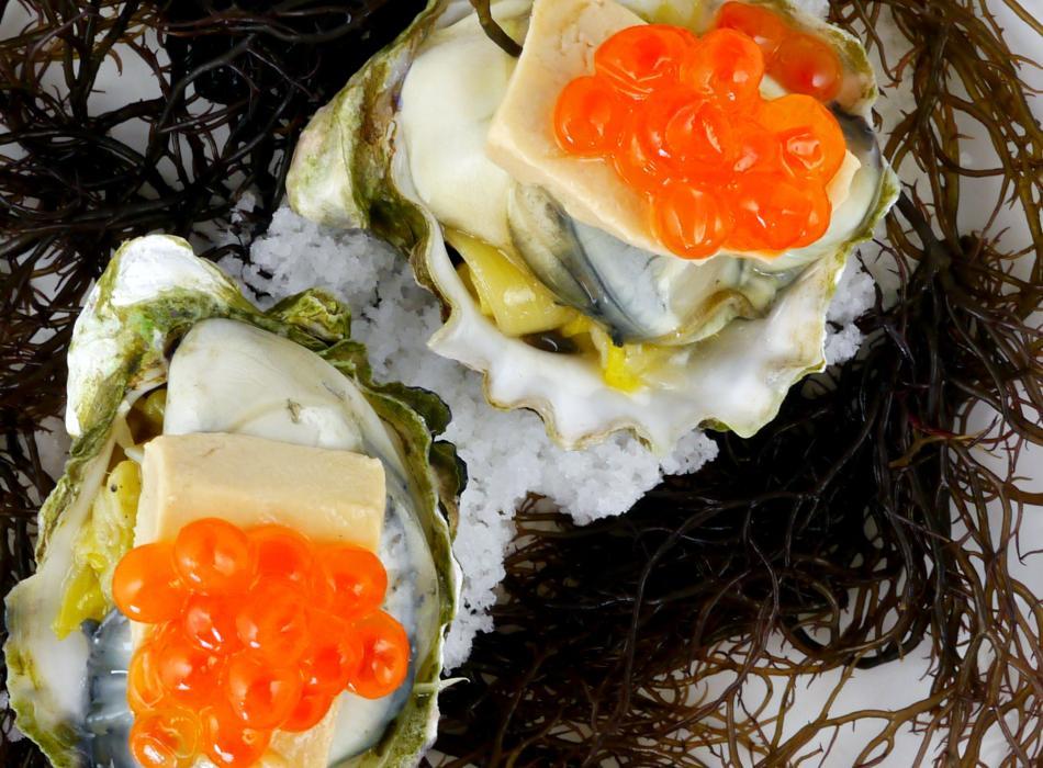 Poached Kumamoto Oysters on baby leek, hudson valley foie gras, ikura