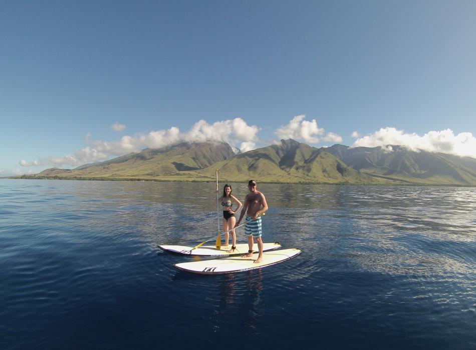 Couple Paddle West Maui Mountains
