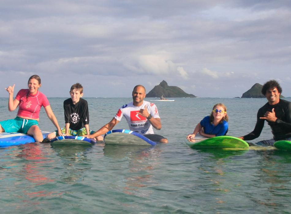 Group shot on surfboards in the water!