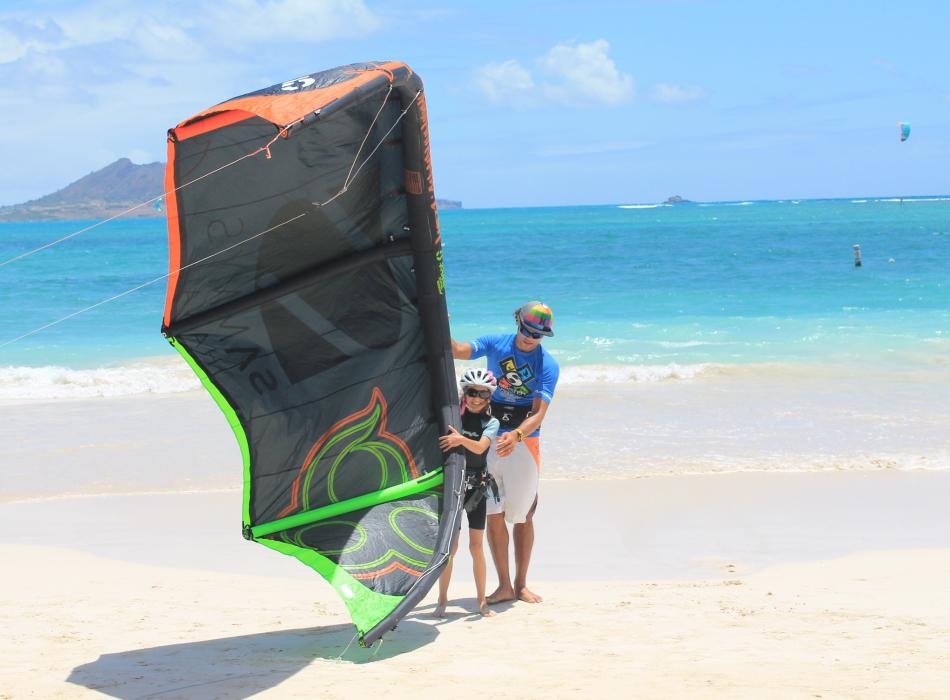 Sammy with youth client and kite on beach