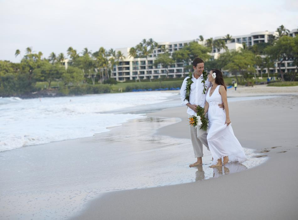 Wedding Couple Strolls Hapuna Beach - A couple enjoys the soft white sands of Hapuna Beach