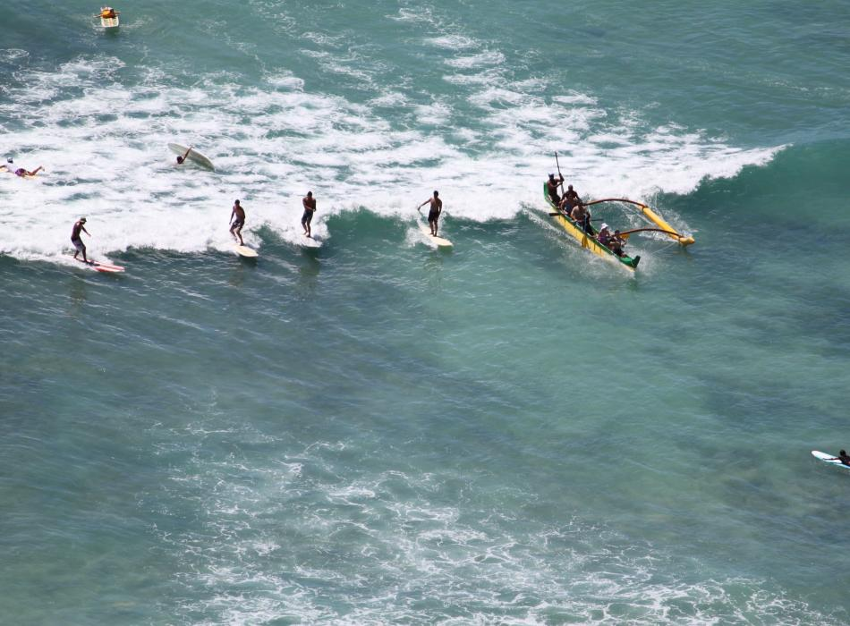 Try surfing, or stand up paddling or go out in an outrigger canoe!