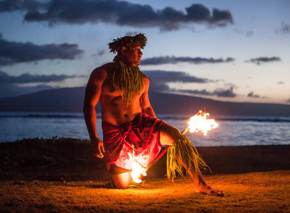 The finale of a luau are the fire dancers