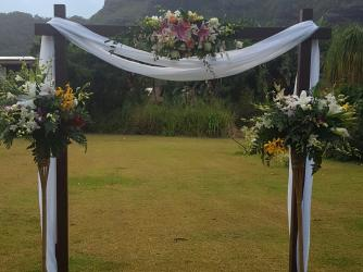 Read more about Flowers Forever · TROPICAL ARCH WITH TIKI SPRAYS. Kauai