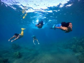Mermaid swimming in Maui